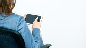 Portrait Back. Business Woman Working with tablet, finger touch. Pad. Sitting in chair.  on white background back  portrait of  business woman Royalty Free Stock Images