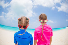 Portrait of back of kids having fun at tropical beach during summer vacation Stock Photos