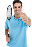 Portrait of badminton player showing thumbs up. On white background Royalty Free Stock Image