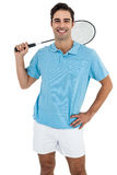 Portrait of badminton player standing with hand on hip. Badminton player standing on white background with hand on hip Stock Images