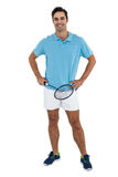 Portrait of badminton player standing with hands on hips. Badminton player standing on white background with hands on hips Stock Images
