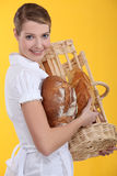 Portrait of a baker. Holding bread Royalty Free Stock Image