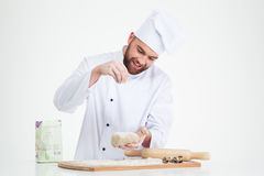 Portrait of a baker preparing dough for pastry Royalty Free Stock Image