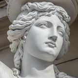 Portrait of balcony support statue of young and naked sensual Roman renaissance era women in Vienna, Austria royalty free stock photos