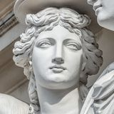 Portrait of balcony support statue of young and naked sensual Roman renaissance era women in Vienna, Austria stock photo