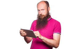 Portrait of bald bearded man with tablet and pink t-shirt Stock Images