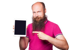 Portrait of bald bearded man with tablet and pink t-shirt Royalty Free Stock Photo