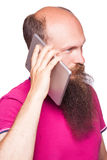 Portrait of bald bearded man with tablet and pink t-shirt Royalty Free Stock Photos