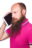 Portrait of bald bearded man with tablet and pink t-shirt. Isolated on white background Stock Image