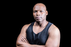 Portrait of bald bodybuilder with arms crossed Royalty Free Stock Photo