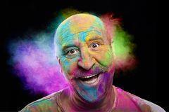Portrait of bald smiling man with colorful face Stock Photography