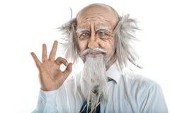 Portrait of bald crazy oldman in studio Stock Images