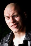 Portrait of a bald gangster in leather jacket stock images