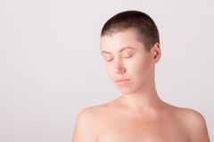 Portrait of bald girl. Close-up portrait of nude bald girl with closed eyes Stock Images