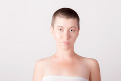 Portrait of bald girl. Close-up portrait of young bald girl with grey eyes Royalty Free Stock Photo