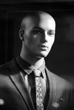 Portrait of bald-headed fashion mannequin. Closeup portrait of illuminated bald-headed fashion mannequin wearing casual male suit made of thready cloth jacket Royalty Free Stock Photo