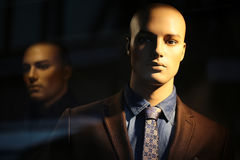 Portrait of bald-headed mannequin. Closeup portrait of illuminated bald-headed fashion mannequin wearing casual male suit made of thready cloth jacket tie shirt Stock Images