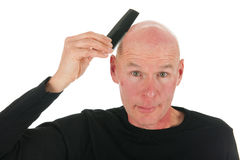 Portrait bald man. Portrait adult bald man with black shirt in studio Royalty Free Stock Photography