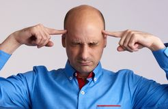 Bald man thinking too hard Stock Image