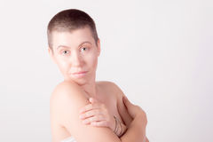 Portrait of bald nude girl. Close-up portrait of young bald girl with grey eyes Royalty Free Stock Photos