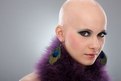Portrait of bald woman in purple boa. Beauty portrait of hairless woman in purple boa, looking at camera Stock Photos