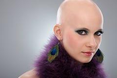 Portrait of bald woman in purple boa Stock Photos