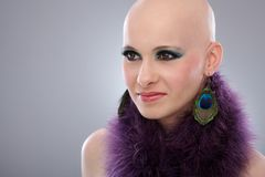 Portrait of bald woman in purple boa. Beauty portrait of hairless woman in purple boa Royalty Free Stock Image