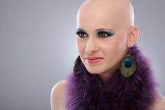 Portrait of bald woman in purple boa Royalty Free Stock Image