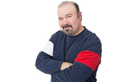 Portrait of a balding mature man. With arms crossed on a white background stock photo