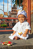Portrait of balinese child in traditional costume - Sarong Stock Image