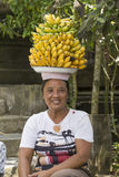 Portrait  balinese woman together with bananas. Indonesia Stock Photo