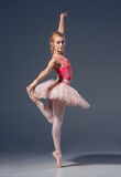 Portrait of the ballerina in ballet pose Royalty Free Stock Images