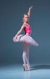 Portrait of the ballerina in ballet pose Royalty Free Stock Image