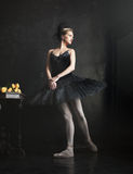 Portrait of the ballerina in ballet tatu on black Stock Photos