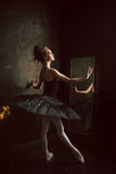 Portrait of the ballerina in ballet tatu on black Royalty Free Stock Photos