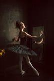 Portrait of the ballerina in ballet tatu on black Royalty Free Stock Photos