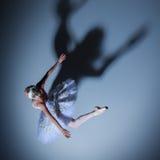 Portrait of the ballerina in ballet tatu on blue Stock Photo