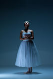 Portrait of the ballerina on blue background Royalty Free Stock Photos