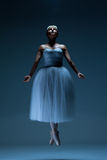 Portrait of the ballerina on blue background Royalty Free Stock Photo