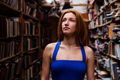 Portrait of ballerina girl in vintage book store wearing casual clothes Stock Photos