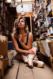 Portrait of ballerina girl in vintage book store wearing casual clothes Stock Image
