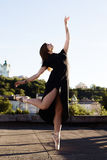 Portrait of ballerina on the roof royalty free stock photo