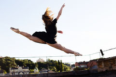 Portrait of ballerina on the roof stock photography