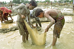 Portrait of Bangladeshi boys working in gravel pit Stock Images