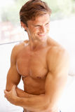 Portrait Of Bare Muscular Torso Of Young Man. Smiling stock photos