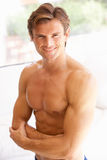 Portrait Of Bare Muscular Torso Of Young Man. Smiling stock image
