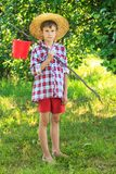 Portrait of barefooted boy on fishing Stock Photography