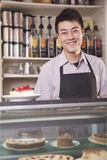 Portrait of barista serving cheesecake Royalty Free Stock Photo