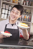Portrait of barista serving cheesecake Stock Image