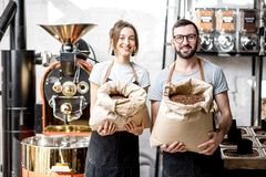 Portrait of baristas with coffee beans Royalty Free Stock Images
